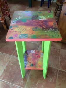 table with mix media painting by Florence Ancillotti